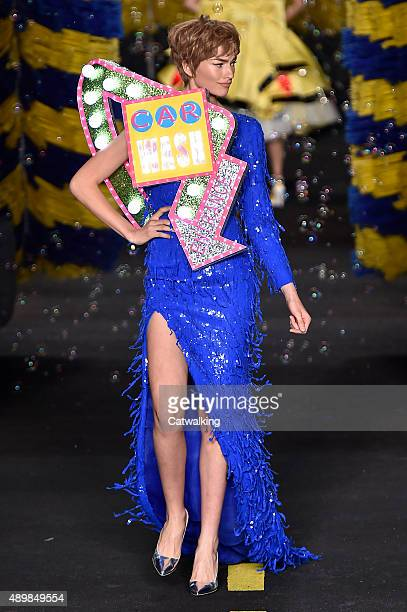 A model walks the runway at the Moschino Spring Summer 2016 fashion show during Milan Fashion Week on September 24 2015 in Milan Italy