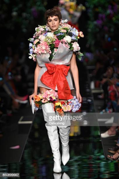 A model walks the runway at the Moschino Spring Summer 2018 fashion show during Milan Fashion Week on September 21 2017 in Milan Italy