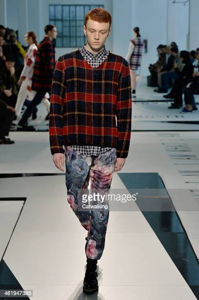 A model walks the runway at the MSGM Autumn Winter 2014 fashion show during Milan Menswear Fashion Week on January 11 2014 in Milan Italy