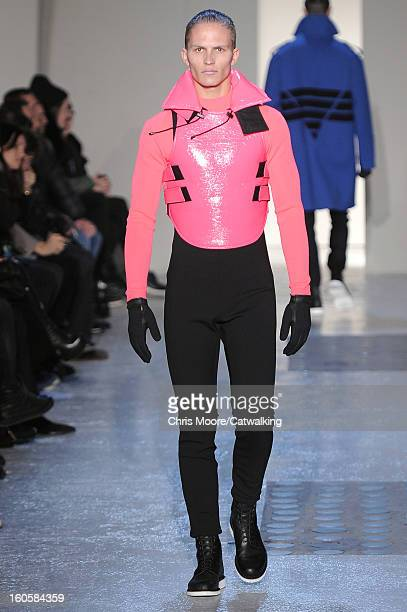 A model walks the runway at the Mugler Autumn Winter 2013 fashion show during Paris Menswear Fashion Week on January 16 2013 in Paris France