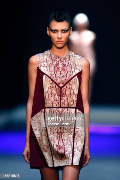 A model walks the runway at The Muscovites By Masha Kravtsova show during MercedesBenz Fashion Week Russia S/S 2014 on October 29 2013 in Moscow...