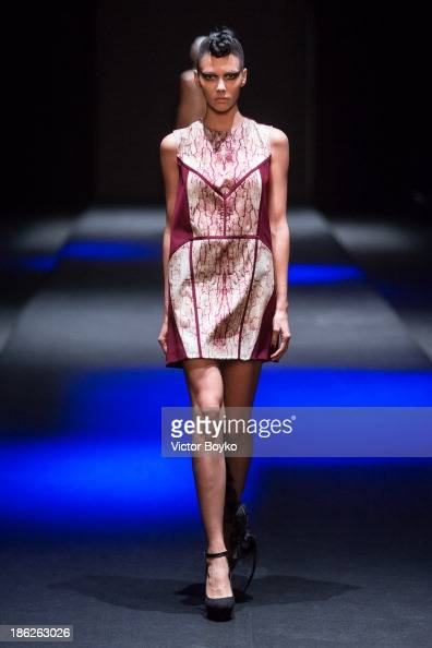Model walks the runway at the Muscovites by Mashsa Kravtsova show of MercedesBenz Fashion Week S/S 14 on October 29 2013 in Moscow Russia