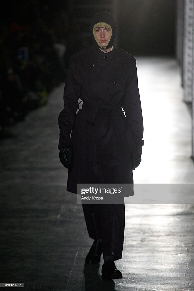 A model walks the runway at the N. Hoolywood fall 2013 fashion show during Mercedes-Benz Fashion Week at The Waterfront on February 7, 2013 in New York City.