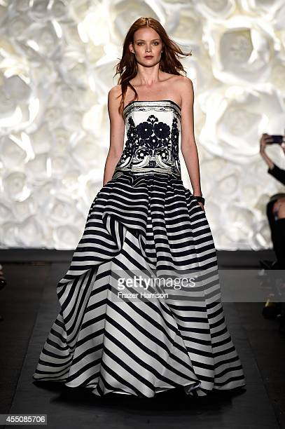 A model walks the runway at the Naeem Khan fashion show during MercedesBenz Fashion Week Spring 2015 at The Theatre at Lincoln Center on September 9...
