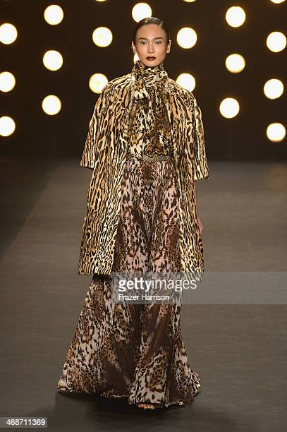 A model walks the runway at the Naeem Khan fashion show during MercedesBenz Fashion Week Fall 2014 at The Theatre at Lincoln Center on February 11...