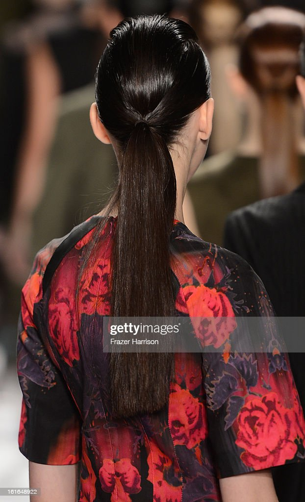 A model (hair detail) walks the runway at the Nanette Lepore Fall 2013 fashion show during Mercedes-Benz Fashion Week at The Stage at Lincoln Center on February 13, 2013 in New York City.