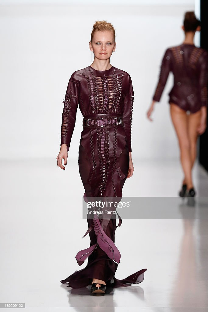 A model walks the runway at the Natalia Goncharova show during Mercedes-Benz Fashion Week Russia S/S 2014 on October 29, 2013 in Moscow, Russia.