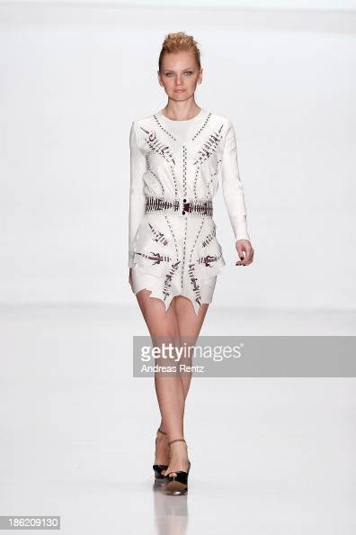 A model walks the runway at the Natalia Goncharova show during MercedesBenz Fashion Week Russia S/S 2014 on October 29 2013 in Moscow Russia