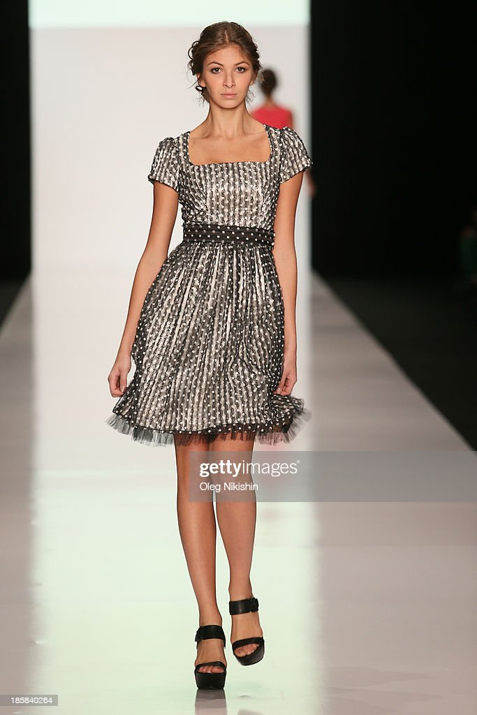 A model walks the runway at the Natalia Slavina For Manufacturing Company 'AN-2' show during the Mercedes-Benz Fashion Week Russia S/S 2014 on October 25, 2013 in Moscow, Russia.