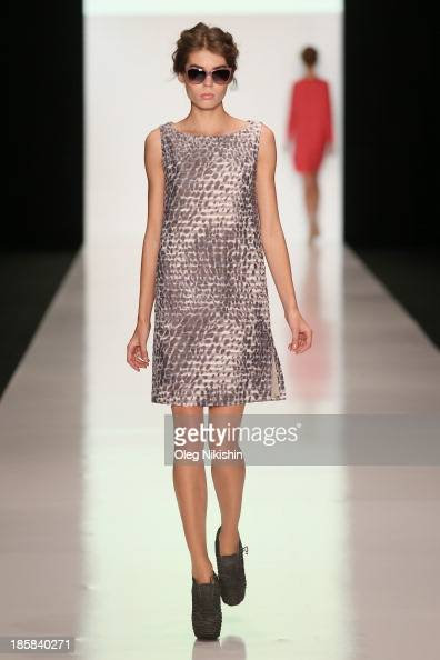 A model walks the runway at the Natalia Slavina For Manufacturing Company 'AN2' show during the MercedesBenz Fashion Week Russia S/S 2014 on October...