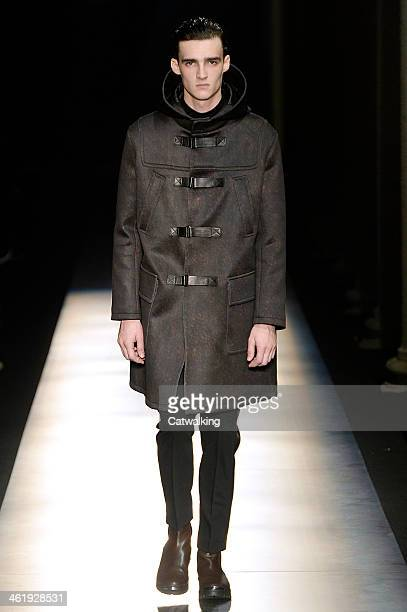 A model walks the runway at the Neil Barrett Autumn Winter 2014 fashion show during Milan Menswear Fashion Week on January 11 2014 in Milan Italy
