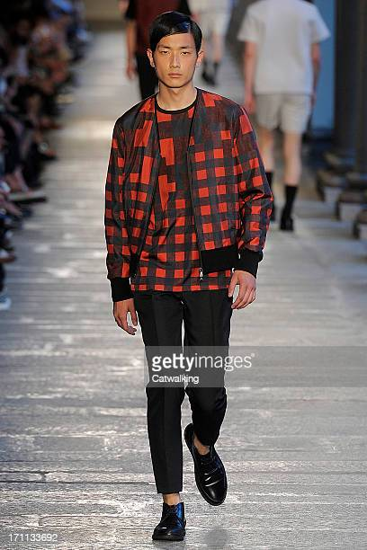 A model walks the runway at the Neil Barrett Spring Summer 2014 fashion show during Milan Menswear Fashion Week on June 22 2013 in Milan Italy