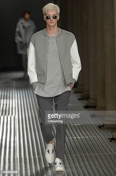 A model walks the runway at the Neil Barrett Spring Summer 2015 fashion show during Milan Menswear Fashion Week on June 21 2014 in Milan Italy