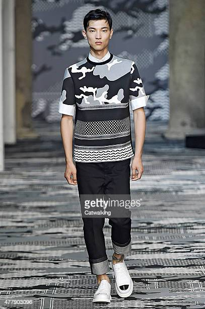 A model walks the runway at the Neil Barrett Spring Summer 2016 fashion show during Milan Menswear Fashion Week on June 20 2015 in Milan Italy