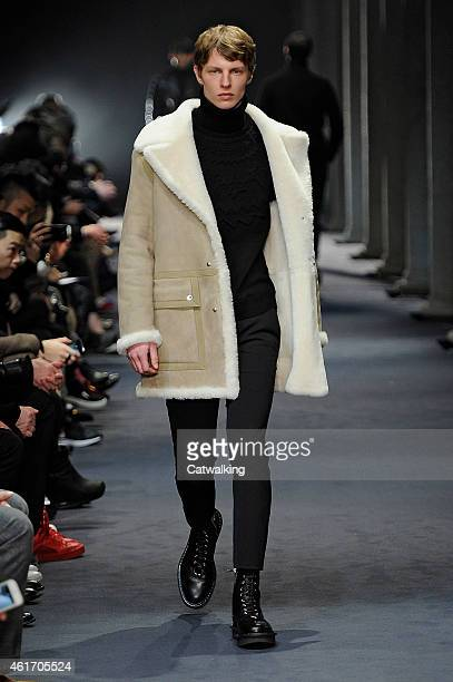 A model walks the runway at the Neill Barrett Autumn Winter 2015 fashion show during Milan Menswear Fashion Week on January 17 2015 in Milan Italy