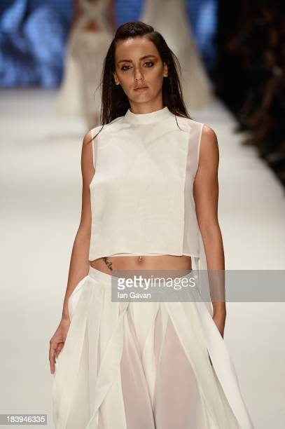 A model walks the runway at the Nej show during MercedesBenz Fashion Week Istanbul s/s 2014 Presented By American Express on October 10 2013 in...