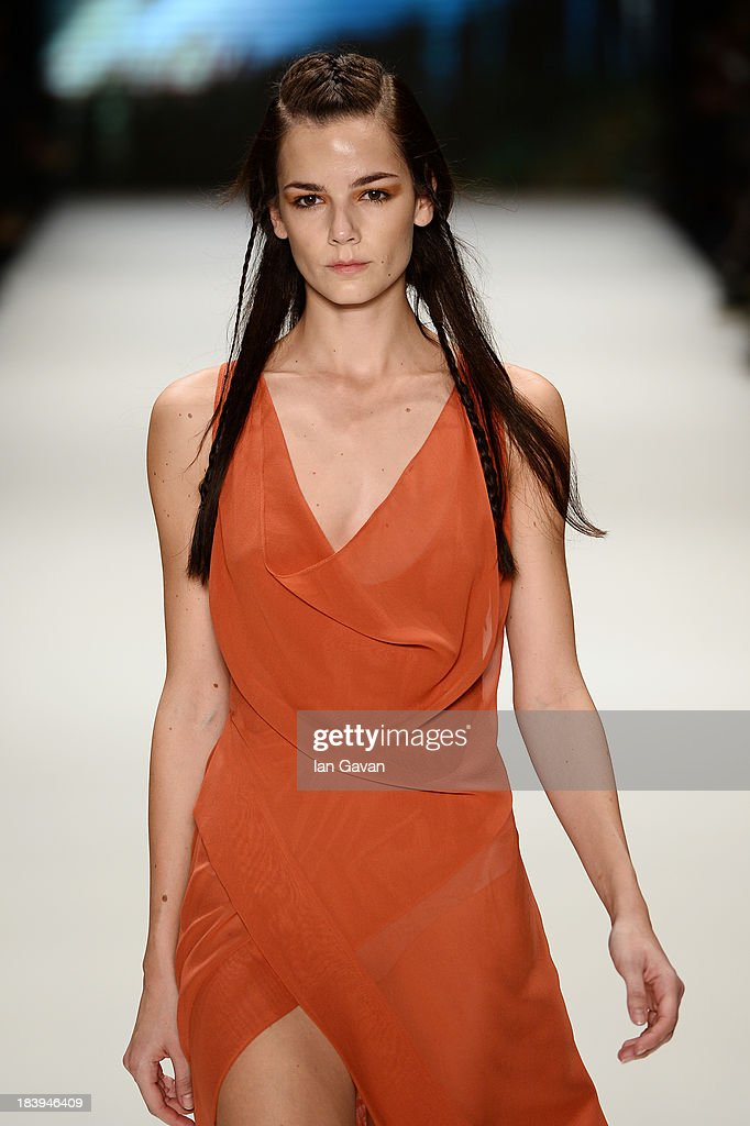 A model walks the runway at the Nej show during Mercedes-Benz Fashion Week Istanbul s/s 2014 Presented By American Express on October 10, 2013 in Istanbul, Turkey.
