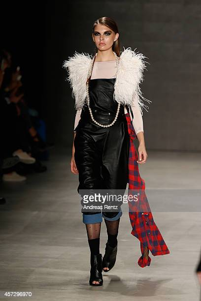 A model walks the runway at the New Gen II show during Mercedes Benz Fashion Week Istanbul SS15 at Antrepo 3 on October 16 2014 in Istanbul Turkey