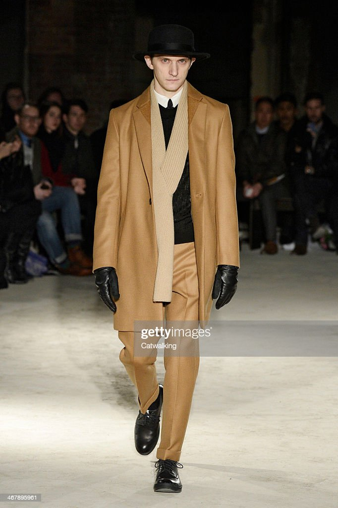 A model walks the runway at the N.Hoolywood Autumn Winter 2014 fashion show during New York Fashion Week on February 7, 2014 in New York, United States.