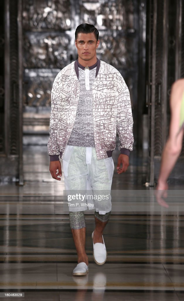 A model walks the runway at the Nian show during at the Fashion Scout venue during London Fashion Week SS14 at Freemasons Hall on September 13, 2013 in London, England.