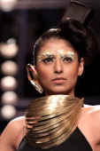 A model walks the runway at the NID Ahmedabad show during day three of the India International Jewellery Week 2014 at Grand Hyatt on July 16 2014 in...