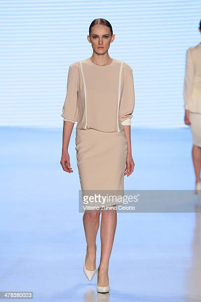 A model walks the runway at the Nihan Peker show during MBFWI presented by American Express Fall/Winter 2014 on March 13 2014 in Istanbul Turkey