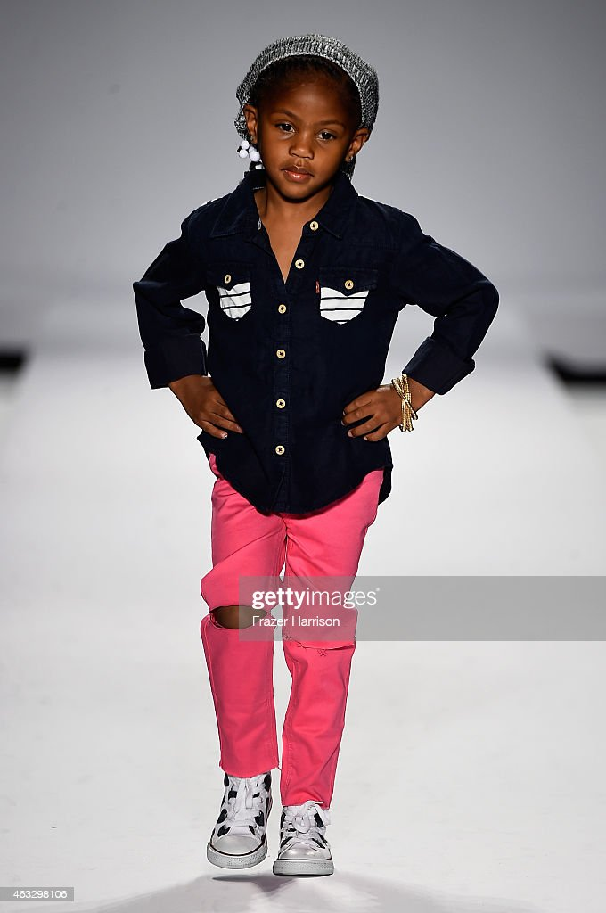 Model walks the runway at the nike levi s kids fashion show during