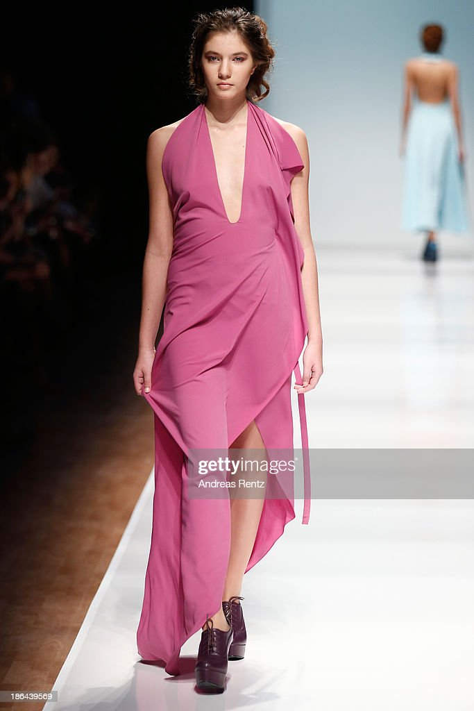A model walks the runway at the Nikolai Kyvyrzhik by SLAVA ZAITSEV during Mercedes-Benz Fashion Week Russia S/S 2014 on October 31, 2013 in Moscow, Russia.