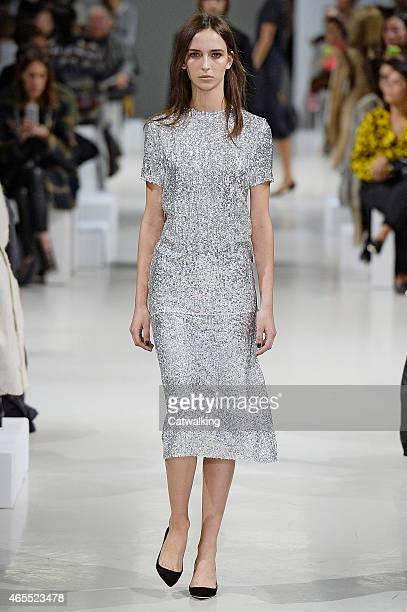 A model walks the runway at the Nina Ricci Autumn Winter 2015 fashion show during Paris Fashion Week on March 7 2015 in Paris France