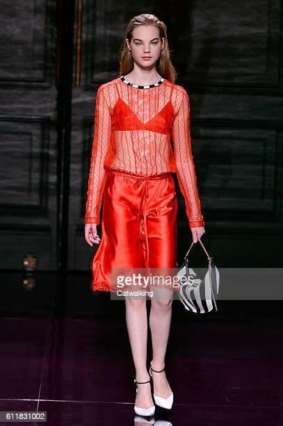 A model walks the runway at the Nina Ricci Spring Summer 2017 fashion show during Paris Fashion Week on October 1 2016 in Paris France