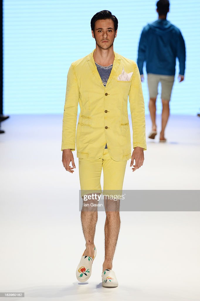A model walks the runway at the Niyazi Erdogan show during Mercedes-Benz Fashion Week Istanbul s/s 2014 Presented By American Express on October 10, 2013 in Istanbul, Turkey.