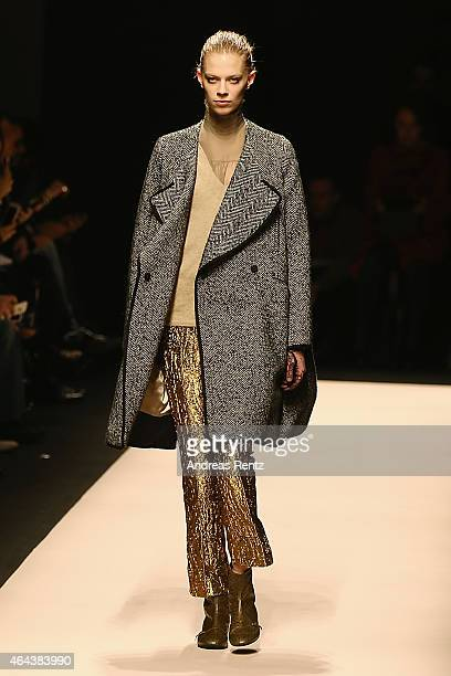 A model walks the runway at the No21 show during the Milan Fashion Week Autumn/Winter 2015 on February 25 2015 in Milan Italy