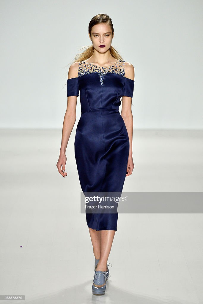 A model walks the runway at the Noon By Noor fashion show during Mercedes-Benz Fashion Week Fall 2014 at The Salon at Lincoln Center on February 10, 2014 in New York City.