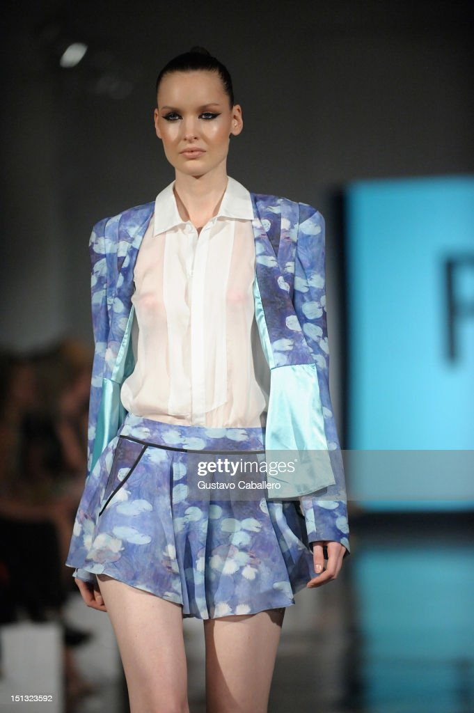 A model walks the runway at the NYFW S/S 2013: 'PIJU' Collection Launch at New York Fashion Palette at Dream Downtown on September 5, 2012 in New York City.