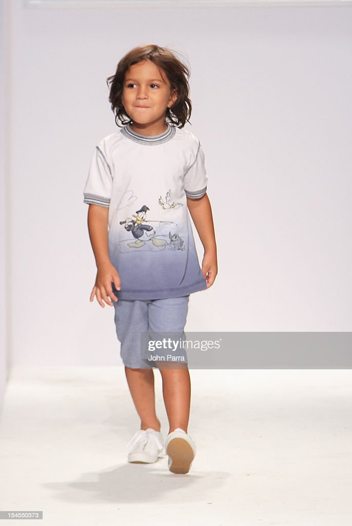 A model walks the runway at the NY&LON show during Petite Parade NY Kids Fashion Week In Collaboration With VOGUEbambini - Day 2 at Industria Superstudio on October 21, 2012 in New York City.
