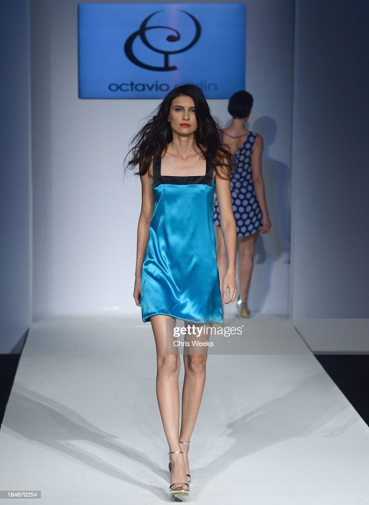 A model walks the runway at the Octavio Carlin Spring 2014 collection show at Style Fashion Week on October 14, 2013 in Los Angeles, California.