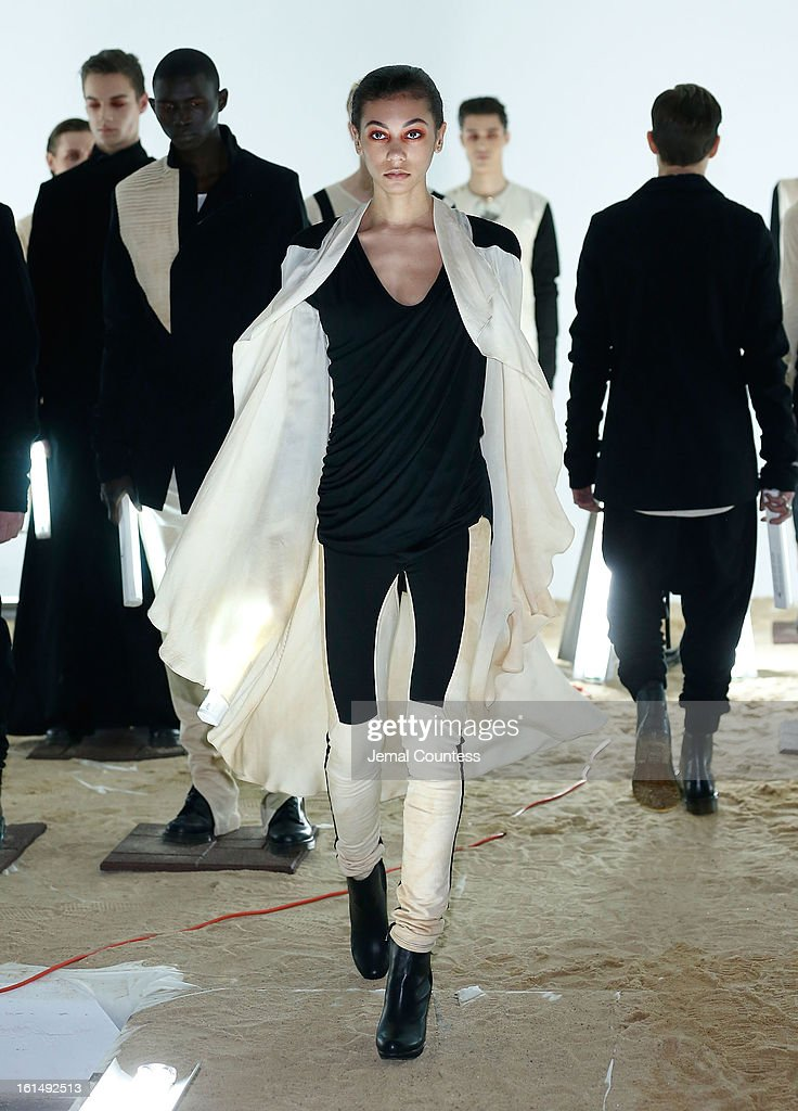 A model walks the runway at the Odd fall 2013 presentation during Mercedes-Benz Fashion Week at Industria Superstudio on February 11, 2013 in New York City.