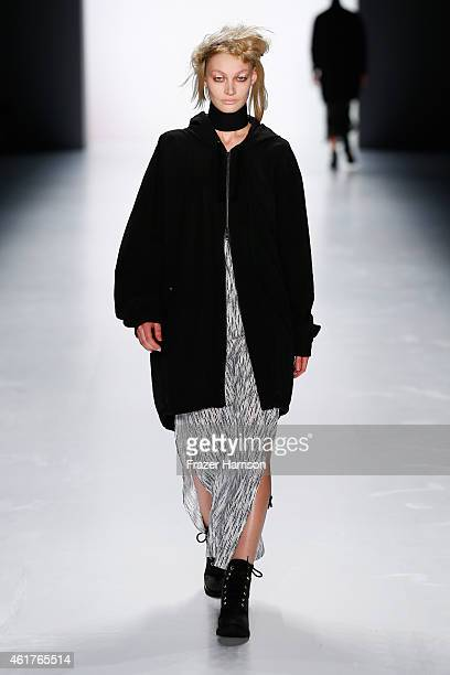 A model walks the runway at the Odeur show during the MercedesBenz Fashion Week Berlin Autumn/Winter 2015/16 at Brandenburg Gate on January 19 2015...
