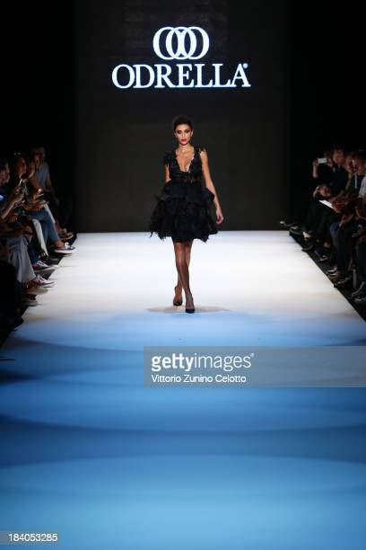 A model walks the runway at the Odrella show during MercedesBenz Fashion Week Istanbul s/s 2014 Presented By American Express on October 11 2013 in...