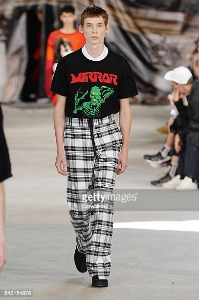 A model walks the runway at the OffWhite Spring Summer 2017 fashion show during Paris Menswear Fashion Week on June 26 2016 in Paris France