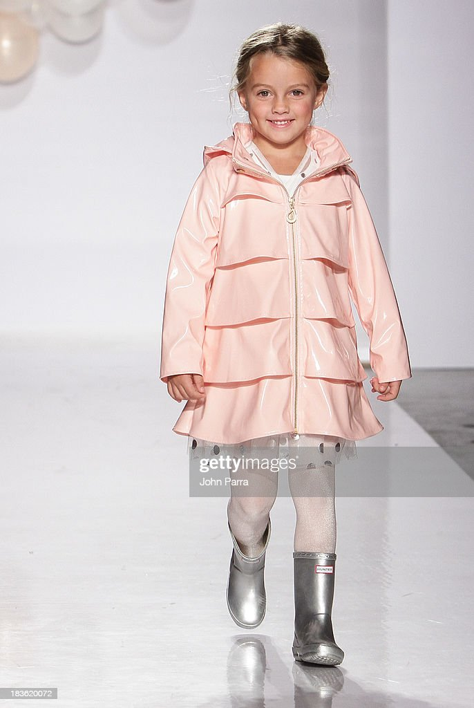 A model walks the runway at the Oil & Water preview during the VOGUEbambini Showcase at petiteParade NY Kids Fahion Week at Industria Superstudio on October 6, 2013 in New York City.