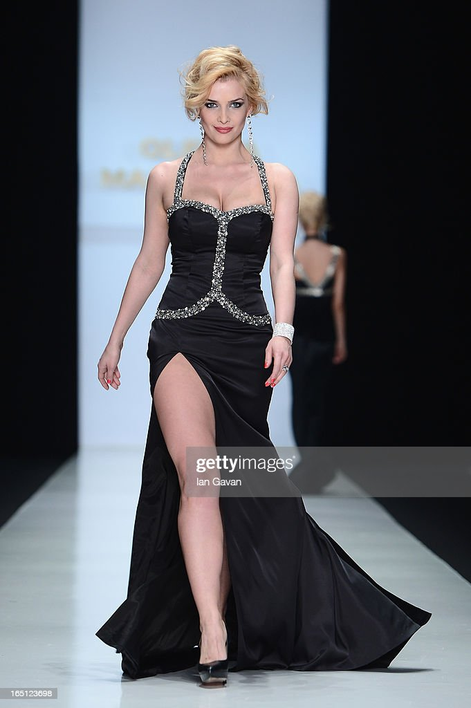 A model walks the runway at the Olesya Malinskaya show during Mercedes-Benz Fashion Week Russia Fall/Winter 2013/2014 at Manege on March 31, 2013 in Moscow, Russia.