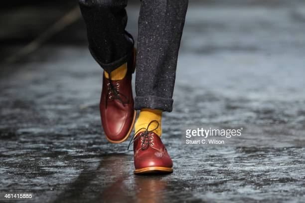 A model walks the runway at the Oliver Spencer show during The London Collections Men Autumn/Winter 2014 on January 8 2014 in London England