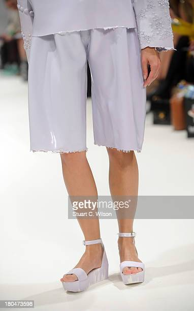 A model walks the runway at the Ones To Watch show during at the Fashion Scout venue during London Fashion Week SS14 at Freemasons Hall on September...