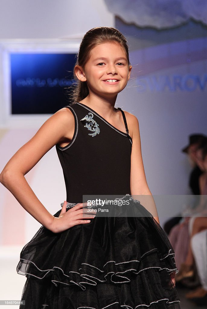 A model walks the runway at the Ooh La La show during the Swarovski Elements at Petite Parade NY Kids Fashion Week In Collaboration With VOGUEbambini - Day 2 at Industria Superstudio on October 21, 2012 in New York City.