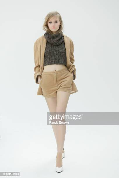 A model walks the runway at the Organic by John Patrick presentation during Fall 2013 MercedesBenz Fashion Week on February 6 2013 in New York City