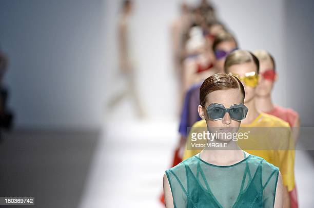 A model walks the runway at the Osklen Ready to Wear fashion show during MercedesBenz Fashion Week Spring Summer 2014 at The Stage at Lincoln Center...