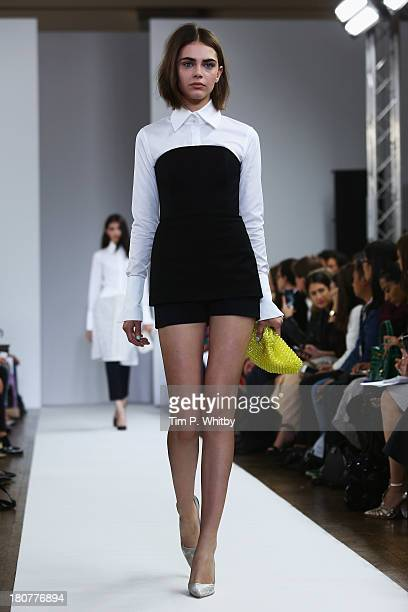A model walks the runway at the Osman show during London Fashion Week SS14 at Victoria House on September 16 2013 in London England