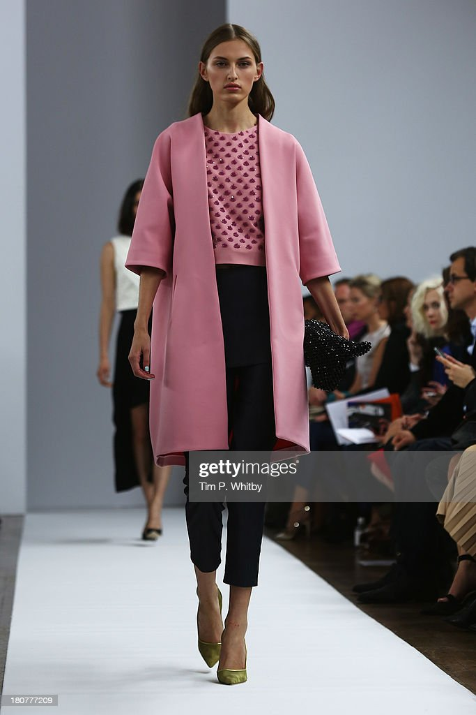 A model walks the runway at the Osman show during London Fashion Week SS14 at Victoria House on September 16, 2013 in London, England.