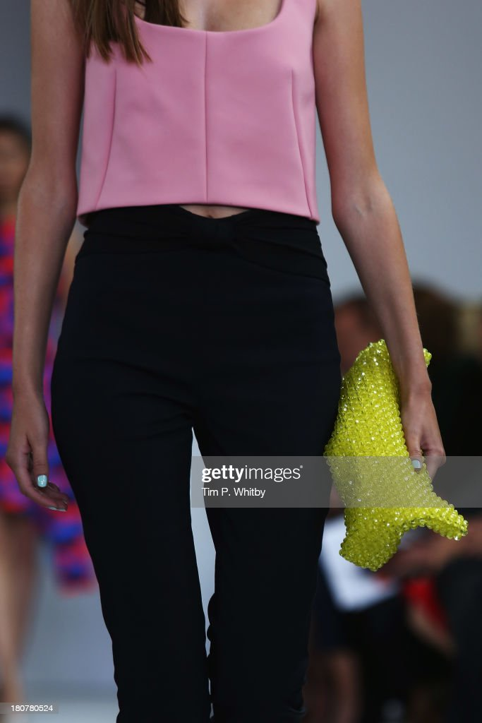 A model (fashion detail) walks the runway at the Osman show during London Fashion Week SS14 at Victoria House on September 16, 2013 in London, England.